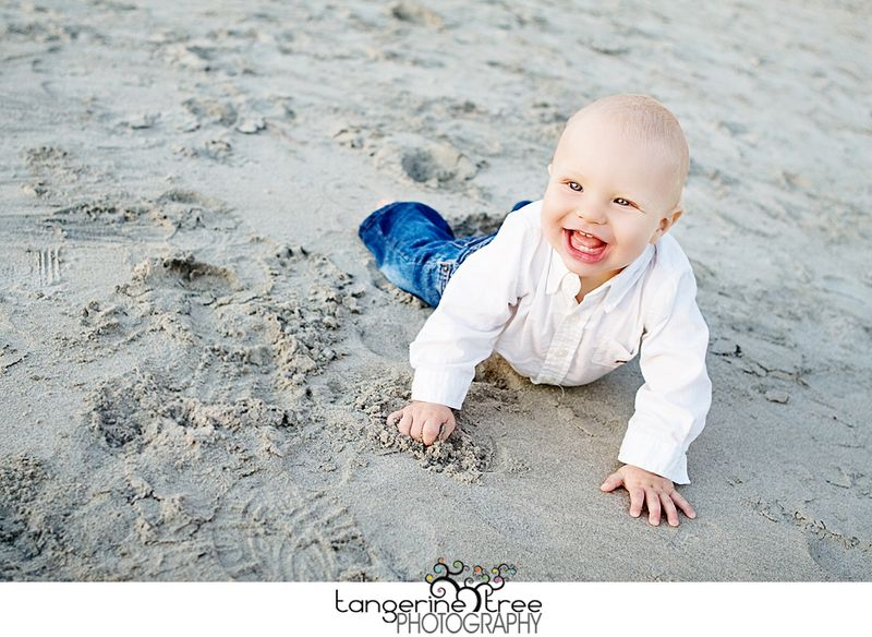 Adorable baby laying in sand