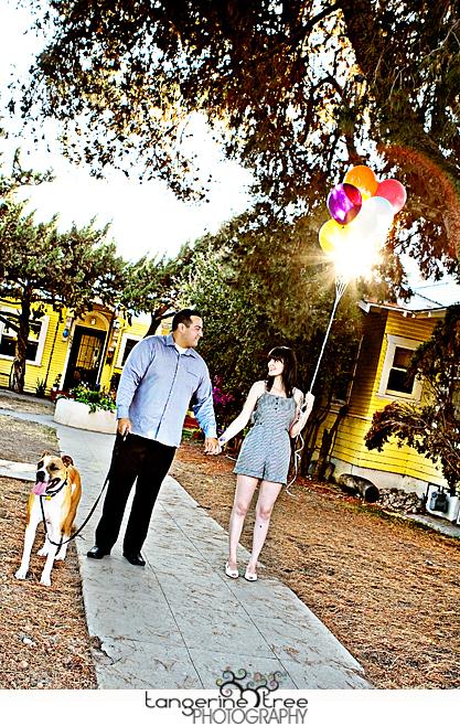 Couple with ballons and dog